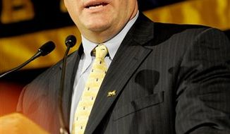 University of Michigan athletic director Dave Brandon announces that head football coach Rich Rodriguez has been fired during an NCAA college football news conference in Ann Arbor, Mich., Wednesday, Jan. 5, 2011. Rodriguez was let go after going 15-22 in three years at Michigan and a handful of NCAA violations that have stained the once-proud program. The school can buy out the final three years of his contract for $2.5 million.(AP Photo/Paul Sancya)