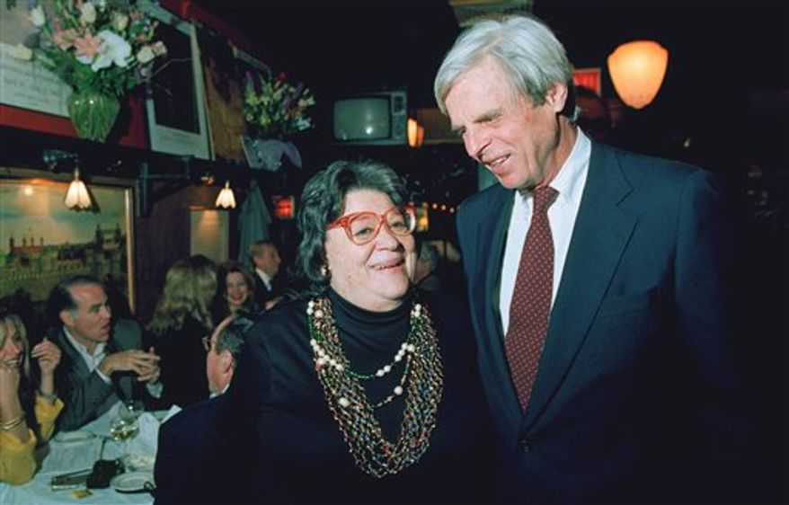 "FILE - In this April 27, 1993 file photo, restaurateur Elaine Kaufman, left, stands with author George Plimpton at her restaurant ""Elaine's"" in New York. Kaufman, whose East Side establishment became a haven for show business and literary notables, died Friday, Dec. 3, 2010 at the age of 81. (AP Photo/Alex Brandon, File)"