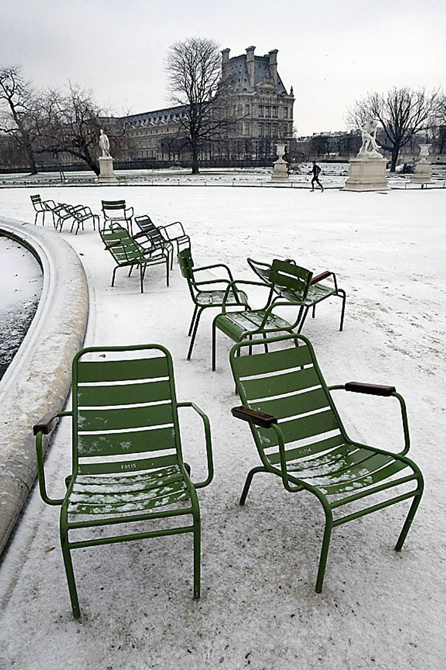 Empty chairs are seen in the Tuileries garden in Paris as freezing temperatures swept the French capital Thursday Dec. 2, 2010. Heavy snow and subzero temperatures swept across Europe, killing at least eight homeless people in Poland, closing major airports in Britain and Switzerland, and causing delays to rail and road traffic across the continent.(AP Photo/Remy de la Mauviniere)