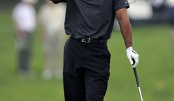 Tiger Woods reacts to his tee shot on the third hole during the second round of the Chevron World Challenge golf tournament at Sherwood Country Club on Friday, Dec. 3, 2010, in Thousand Oaks, Calif. (AP Photo/Mark J. Terrill)