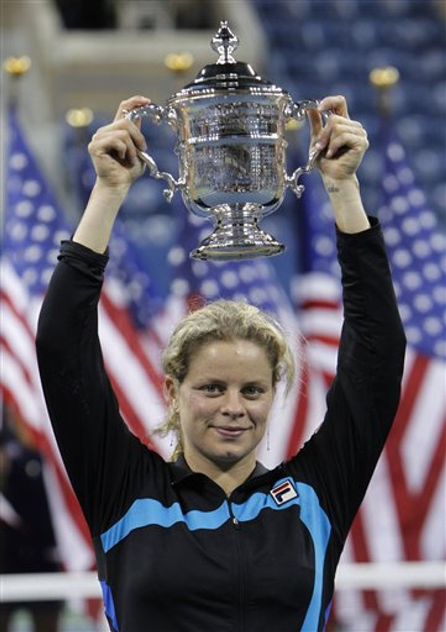 FILE - This Oct. 31, 2010, file photo shows Belgium's Kim Clijsters celebrating after she beat Denmark's Caroline Wozniack in the final match of the Qatar WTA Tennis Championship in Doha, Qatar.  Clijsters has won the WTA's player of the year award, Wednesday, Dec. 1, 2010. (AP Photo/Kamran Jebreili, File)