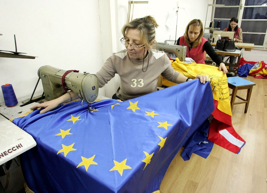 Flags of the European Union were sewn in a Belgrade workshop in 2005 despite anti-Western violence by nationalists and Serbian leaders' pledge to shelve attempts to join the EU. Now, however, the country appears determined to shed its negative aura and focus on joining the Continent's club of responsible Western democracies. (Associated Press)
