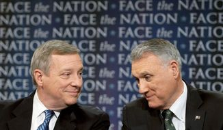 "ALMOST EYE TO EYE: Senate Majority Whip Richard Durbin (left), Illinois Democrat, and Minority Whip Jon Kyl, Arizona Republican, discuss lame-duck legislation issues Sunday on ""Face the Nation."" (Associated Press)"