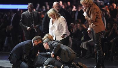 Contestant Samuel Koch, wearing spring shoes, attempts to jumps over a moving car, driven by his father, during the live broadcast of  'Wetten dass ?' (Bet it?), a top show  of German TV channel ZDF in Duesseldorf, western Germany, Saturday Dec. 4, 2010. Koch failed during his attempt, crashed to the floor and was taken to a hospital. The show was immediately stopped. Further circumstances and what injuries Koch suffered are unknown at the moment. (AP Photo/  Hermann J. Knippertz/Pool)
