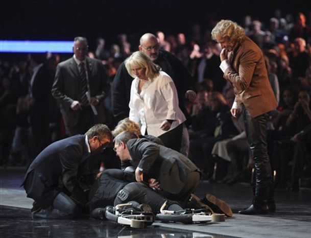 Contestant Samuel Koch, wearing spring shoes, attempts to jumps over a moving car, driven by his father, during the live broadcast of  'Wetten dass ?' (Bet it?), a top show  of German TV channel ZDF in Duesseldorf, western Germany, Saturday Dec. 4, 2010. Koch failed during his attempt, crashed to the floor and was taken to a hospital. The s