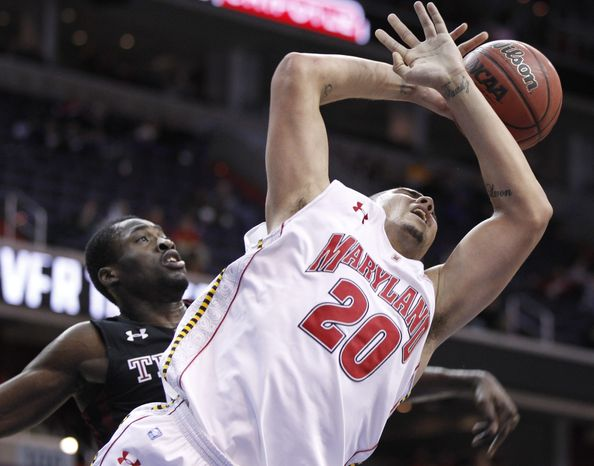 Maryland's Jordan Williams (20) is fouled by Temple's Micheal Eric, left, during first half of an NCAA college basketball game at the 16th Annual BB&T Classic in Washington, Sunday, Dec. 5, 2010. (AP Photo/Luis M. Alvarez)