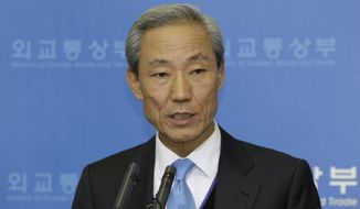 South Korean Trade Minister Kim Jong-hoon speaks about the U.S.-South Korean free-trade agreement during a press conference at the Foreign Ministry in Seoul on Sunday, Dec. 5, 2010. (AP Photo/Ahn Young-joon)