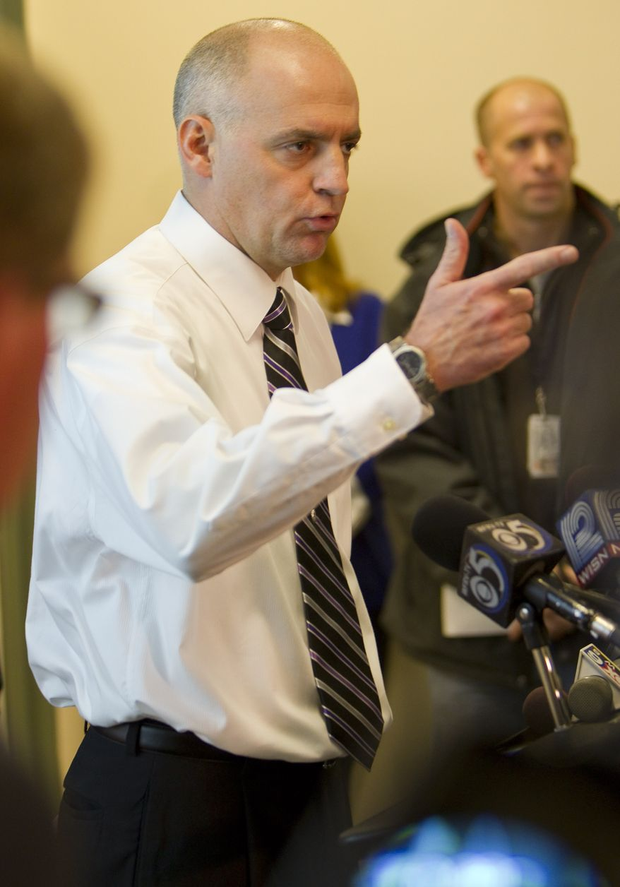 Marinette (Wis.) High School Principal Corry Lambie talks on Tuesday, Nov. 30, 2010, about how a student hostage taker pointed a gun at him Monday and ordered him away from a classroom. (AP Photo/Mike Roemer)