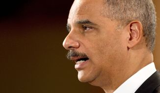 "Attorney General Eric H. Holder Jr. answers questions Monday during a news conference at the Justice Department about the sucesses of ""Operation Broken Trust,"" a federal task force targeting investment fraud. (Associated Press)"