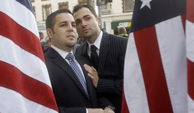 ** FILE ** Jeffrey Zarrillo (left) and Paul Katami, plaintiffs in the Proposition 8 gay-marriage case, are seen outside the federal courthouse before a hearing in the 9th U.S. Circuit Court of Appeals on Monday, Dec. 6, 2010, in San Francisco. (AP Photo/Jeff Chiu)
