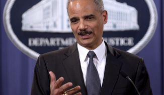 "Attorney General Eric H. Holder Jr. announcing the results of ""Operation Broken Trust,"" a three-and-a-half-month operation targeting investment fraud, at the Justice Department in Washington, Monday, Dec. 6, 2010. (AP Photo/Evan Vucci)"