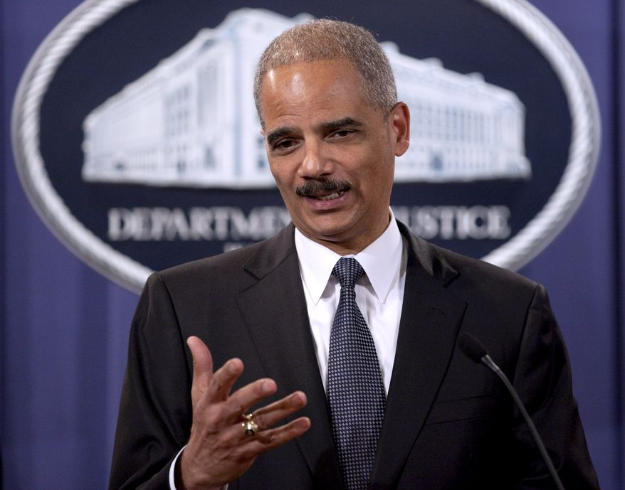 """Attorney General Eric H. Holder Jr. announcing the results of """"Operation Broken Trust,"""" a three-and-a-half-month operation targeting investment fraud, at the Justice Department in Washington, Monday, Dec. 6, 2010. (AP Photo/Evan Vucci)"""