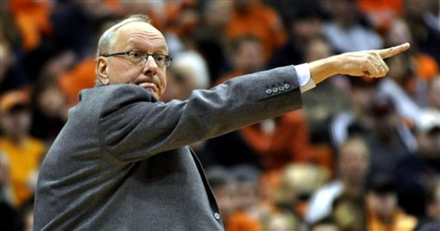 Syracuse head coach Jim Boeheim directs his players against N.C. State during the second half of an NCAA college basketball game in Syracuse, N.Y., Saturday, Dec. 4, 2010. Syracuse won 65-59. (AP Photo/Kevin Rivoli)