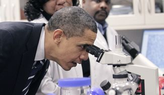 President Obama looks through a microscope during his tour the Bio-technology program at Forsyth Tech Community College in Winston-Salem, N.C., Monday, Dec. 6, 2010. (AP Photo/Pablo Martinez Monsivais)