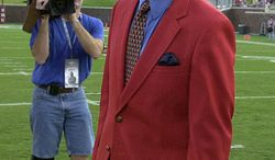** FILE ** Former Dallas Cowboys quarterback Don Meredith walks out for the coin toss before the football game between the U.S. Naval Academy and Southern Methodist University in Dallas in 2002. (AP Photo/L.M. Otero, File)