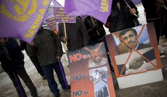 Iranian opposition members demonstrate against the Iranian nuclear program in front the United Nations in Geneva on Monday, Dec. 6, 2010. Delegations of Iran, the European Union, the United States, Russia, Britain, France and Germany are meeting in Geneva for nuclear talks with EU foreign policy chief Catherine Ashton and Saeed Jalili, Iran's chief negotiator. (AP Photo/Anja Niedringhaus)