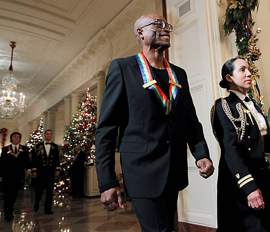 Bill T.  Jones, recipient of the  2010 Kennedy Center Honors, is escorted into the East Room of the White House in Washington for a reception on Sunday, Dec. 5, 2010.  (AP Photo/Manuel Balce Ceneta)