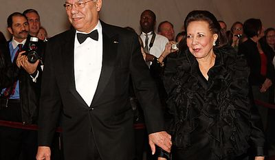 Former Secretary of State Colin Powell and his wife, Alma, arrive at the Kennedy Center Honors in Washington on Sunday, Dec. 5, 2010. (AP Photo/Jacquelyn Martin)