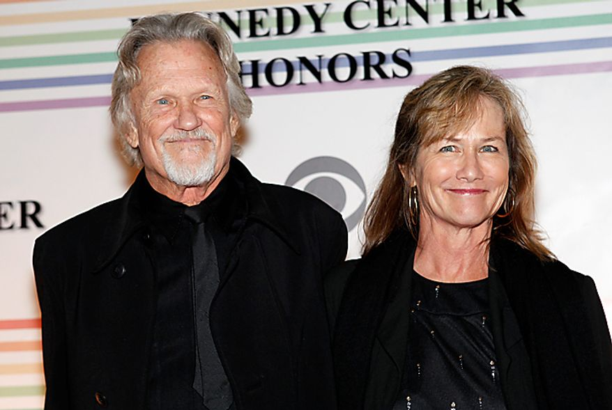 Kris Kristofferson, left, and his wife, Lisa, pose on the red carpet at the Kennedy Center Honors in Washington on Sunday, Dec. 5, 2010. (AP Photo/Jacquelyn Martin)