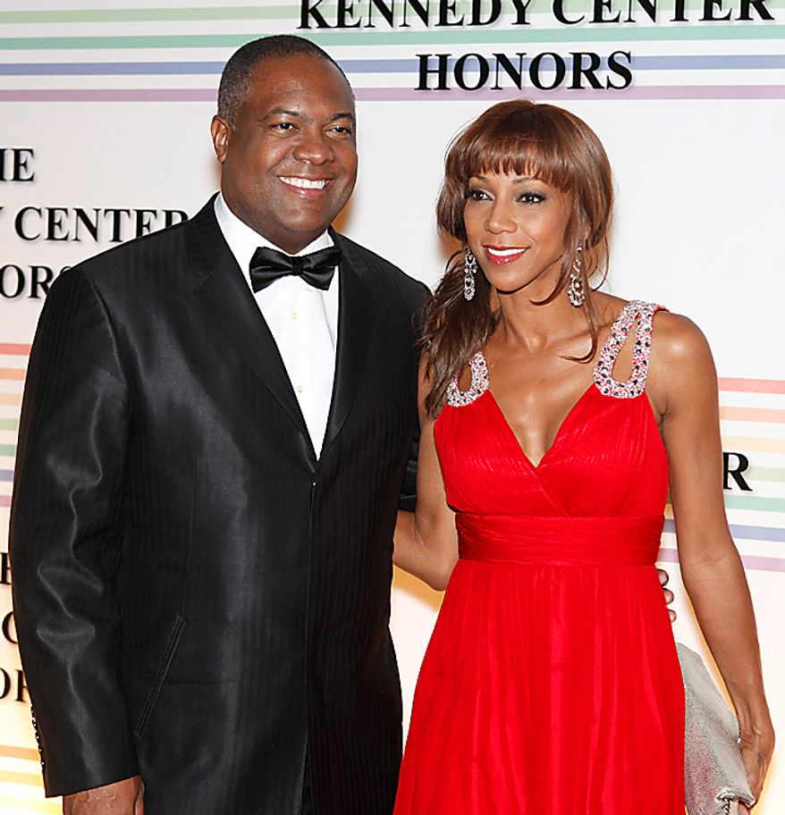 Rodney Peete, left, and Holly Robinson Peete walk the red carpet at the Kennedy Center Honors in Washington on Sunday, Dec. 5, 2010. (AP Photo/Jacquelyn Martin)