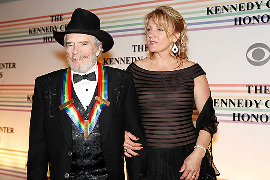 Merle Haggard and Theresa Ann Lane walk the red carpet at the Kennedy Center Honors in Washington on Sunday, Dec. 5, 2010. Mr. Haggard joined fellow honorees Jerry Herman, Bill T. Jones, Paul McCartney and Oprah Winfrey. (AP Photo/Jacquelyn Martin)