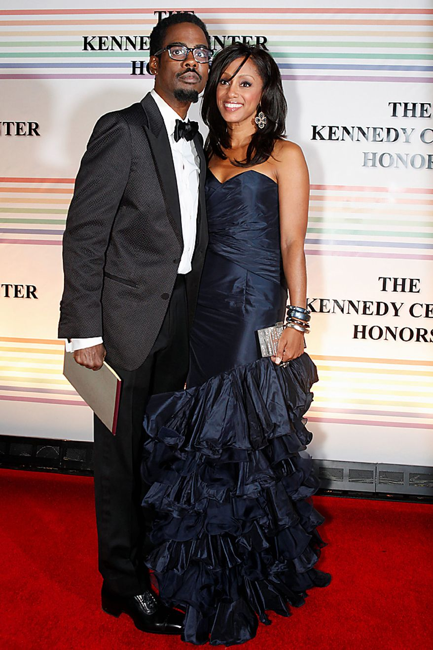 Chris Rock, left, and Malaak Rock walk the red carpet at the Kennedy Center Honors in Washington on Sunday, Dec. 5, 2010. (AP Photo/Jacquelyn Martin)