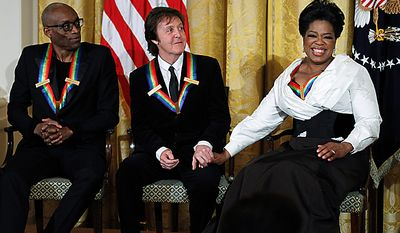 Recipients of the 2010 Kennedy Center Honors -- including, from left, Bill T. Jones, Paul McCartney and Oprah Winfrey -- react to the President Obama's introduction of Mr. McCartney during a reception in the East Room of the White House in Washington on Sunday, Dec. 5, 2010. (AP Photo/Manuel Balce Ceneta)