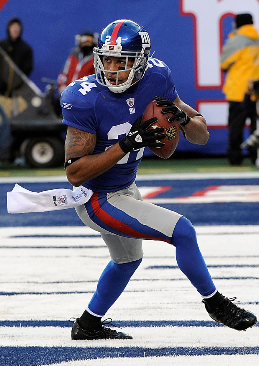 New York Giants cornerback Terrell Thomas (24) looks to run after intercepting a pass during the fourth quarter of an NFL football game against the Washington Redskins at New Meadowlands Stadium, Sunday, Dec. 5, 2010, in East Rutherford, N.J. (AP Photo/Bill Kostroun)