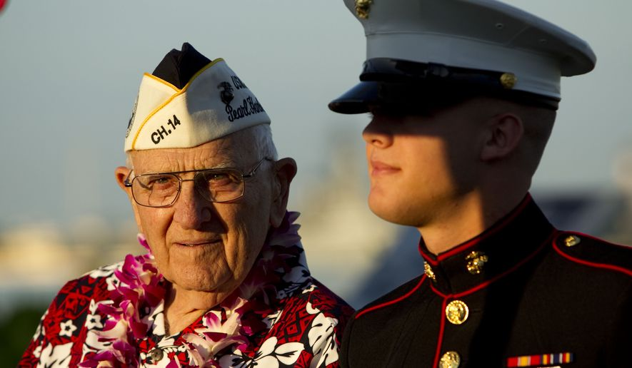 Pearl Harbor survivor John Hughes (left) and Lance Cpl. Zackary Morphew attend the 69th anniversary ceremony marking the attack on Pearl Harbor on Tuesday, Dec. 7, 2010, in Pearl Harbor, Hawaii. (AP Photo/Marco Garcia)