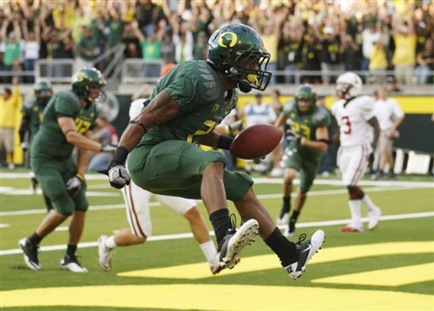 FILE - This Oct. 2, 2010, file photo shows Oregon running back LaMichael James celebrating after scoring against Standford in the second quarter of their NCAA college football game, in Eugene, Ore.  The small yet speedy sophomore is among the four finalists for the Heisman Trophy. (AP Photo/Rick Bowmer, File)