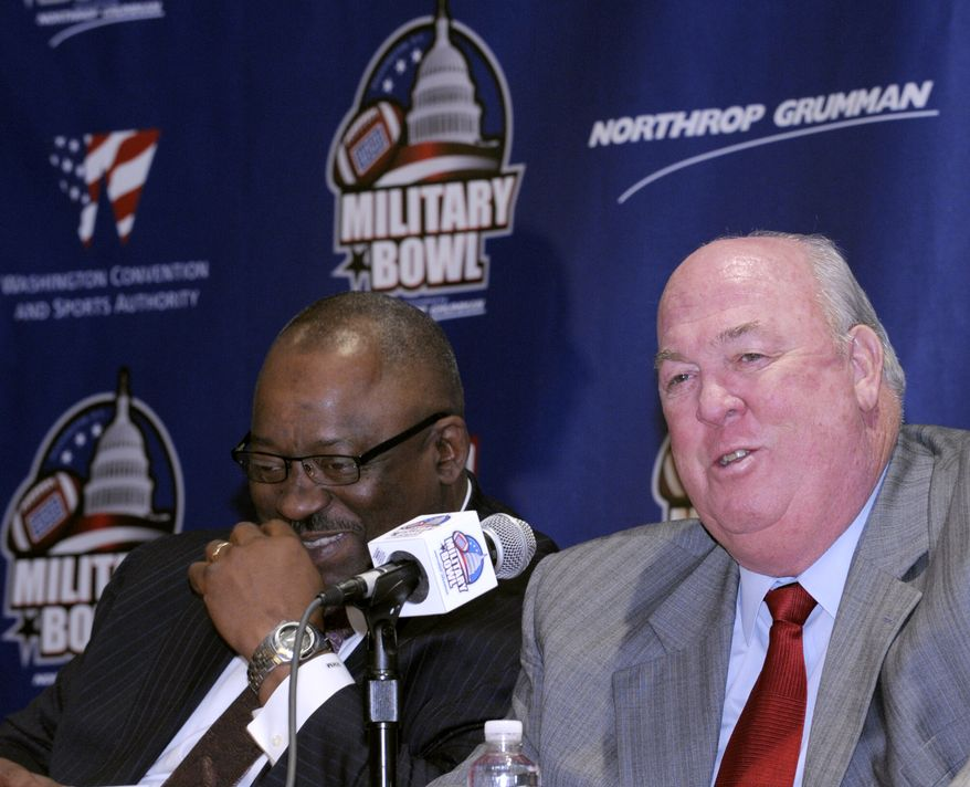 Maryland University football coach Ralph Friedgen, right, and East Carolina University football coach Ruffin McNeill share a laugh during a news conference in Washington, Tuesday, Dec. 7, 2010, to promote the 2010 Military Bowl, presented by Northrop Grumman, to be played at RFK Stadium in Washington on December 29. (AP Photo/Susan Walsh)