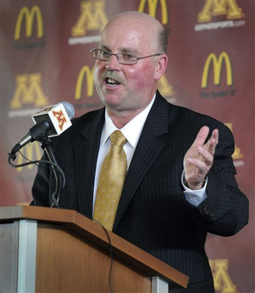 The new Minnesota Gophers head football coach Jerry Kill talks with reporters during a news conference at TCF Stadium in Minneapolis, Minn., Monday, Dec. 6, 2010.  (AP Photo/Craig Lassig)