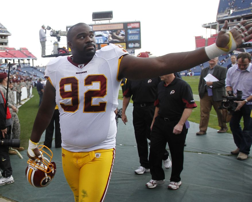 Washington Redskins defensive tackle and former Tennessee Titans player Albert Haynesworth (92) waves to fans as he leaves the field after the Redskins defeated the Titans 19-16 in overtime of an NFL football game on Sunday, Nov. 21, 2010, in Nashville, Tenn. (AP Photo/Mark Humphrey)