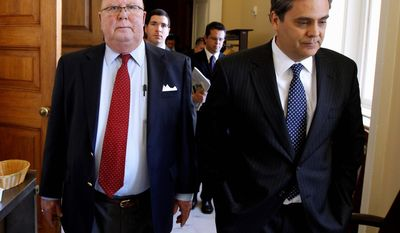 U.S. District Judge G. Thomas Porteous (left) walks with his attorney, Jonathan Turley, on Capitol Hill on Wednesday after the Senate voted on his impeachment. He was removed from the bench. (Associated Press)