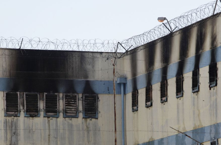 An area of the San Miguel prison is burned after a fire killed at least 81 prisoners in Santiago, Chile, Wednesday Dec. 8, 2010. The prison fire set off during a riot also seriously injured at least 14 others, officials said. (AP Photo/Aliosha Marquez)