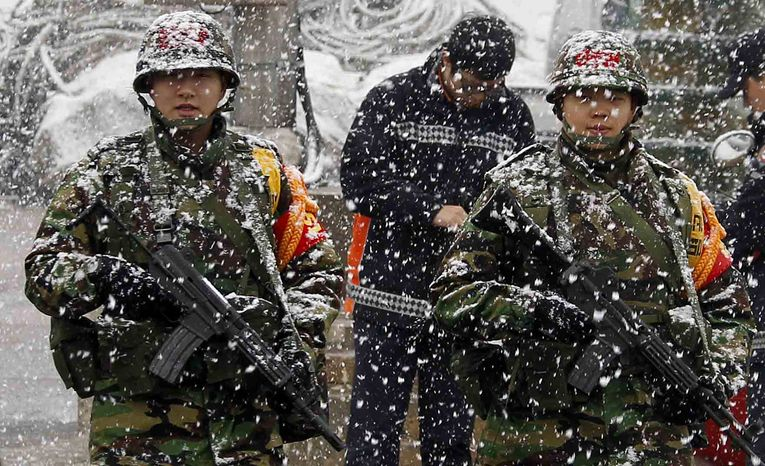 "South Korean Marines patrol in the snow on Yeonpyeong Island, South Korea, Wednesday, Dec. 8, 2010. The top U.S. military officer on Wednesday warned North Korea that the U.S. commitment to helping South Korea defend itself is ""unquestioned,"""