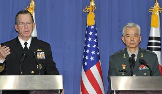 """Joint Chiefs of Staff Chairman Adm. Mike Mullen, at a news conference Wednesday in Seoul with his South Korean counterpart, Gen. Han Min-koo, says China appears """"unwilling"""" to pressure the North. (Associated Press)"""