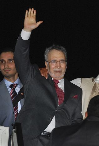 **FILE** In this photo taken Aug. 20, 2009, Libyan Abdel Baset al-Megrahi, who was found guilty of the 1988 Lockerbie bombing, gestures on his arrival at an airport in Tripoli, Libya. Diplomatic cables revealed by WikiLeaks show that the British government feared Libya would take harsh action against it if the Lockerbie bomber died in prison. (Associated Press)