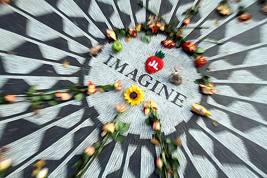The Imagine mosaic in Strawberry Fields is decorated with flowers and other mementos, Tuesday, Dec. 7, 2010, in New York. Wednesday marks 30 years since John Lennon was killed outside his New York apartment, triggering a wave of grief around the world. (AP Photo/Mary Altaffer)