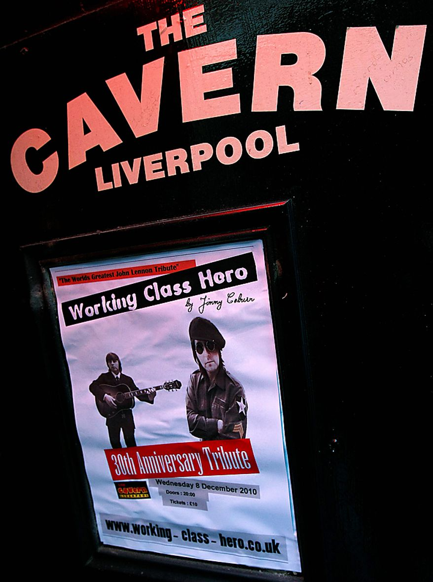 A poster advertising a tribute to John Lennon to be held at the Cavern Club in Mathew Street, Liverpool, England, Wednesday Dec. 8, 2010. Beatles fans planned to mark the 30th anniversary of John Lennon's death with a candlelit vigil at the city's European Peace Monument, which is dedicated to John Lennon. (AP Photo/Tim Hales)
