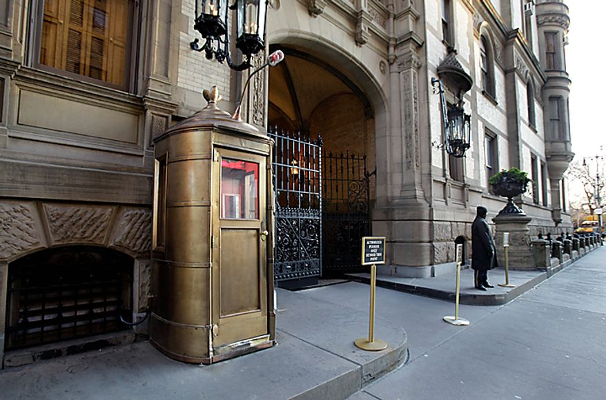 A lone doorman stands outside the Dakota on New York's Upper West Side, Wednesday, Dec. 8, 2010, where John Lennon was shot 30 years ago. (AP Photo/Richard Drew)