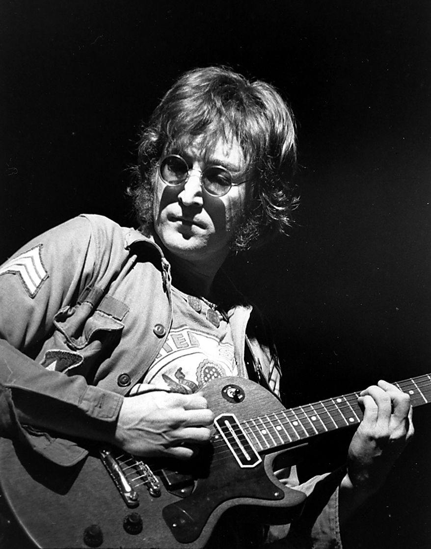 ** FILE ** In this Aug. 30, 1972, file photo, John Lennon performs at New York's Madison Square Garden.  (AP Photo/File)
