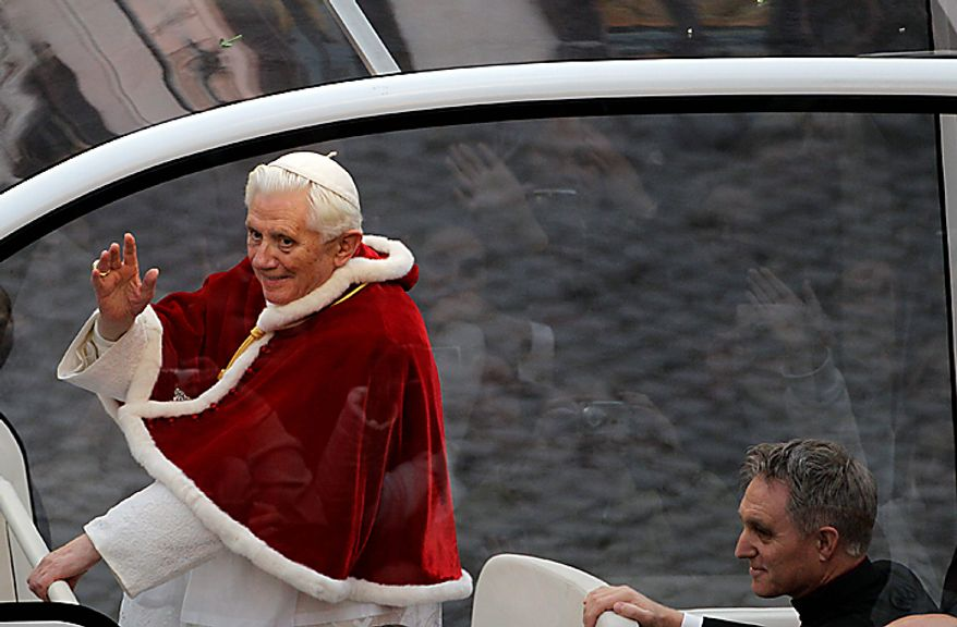 Pope Benedict XVI waves from his popemobile as he arrives for the traditional prayer to celebrate the Immaculate Conception, in Rome, Wednesday Dec. 8, 2010. Pope Benedict XVI inaugurated the Christmas season in Rome with his traditional visit to the posh Spanish Steps neighborhood to pray before a statue of Mary. Throngs of shoppers, tourists and Romans alike jammed the rain-slicked cobblestones around the piazza to catch a glimpse of Benedict as he marked the Catholic Church's feast of the Immaculate Conception. (AP Photo/Alessandra Tarantino)