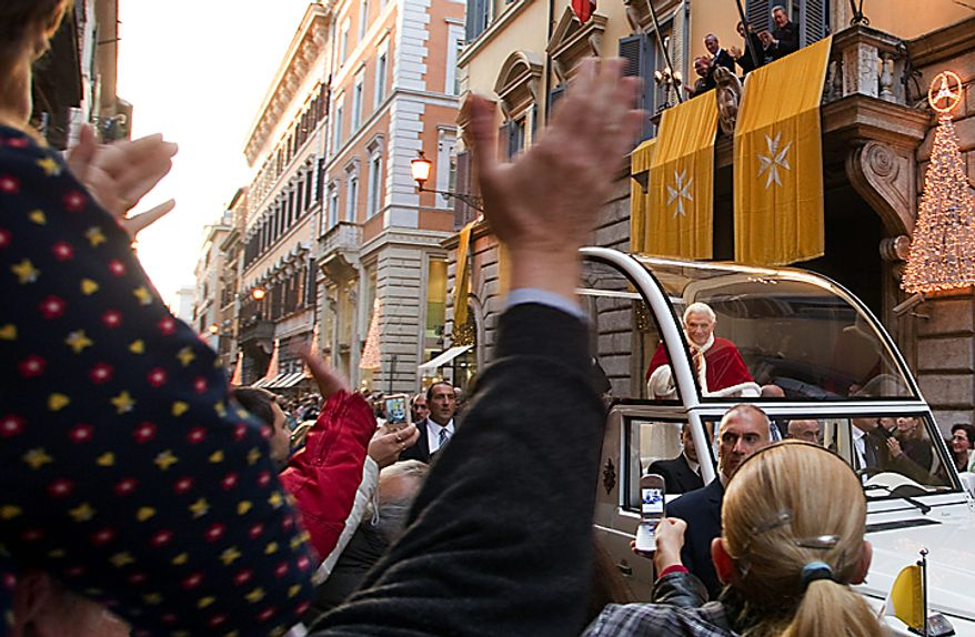 Pope Benedict XVI waves from his popemobile on his way to the Spanish Steps, in Rome, Wednesday, Dec. 8, 2010. Benedict inaugurated the Christmas season in Rome with his traditional visit to the posh Spanish Steps neighborhood to pray before a statue of Mary. Throngs of shoppers, tourists and Romans alike jammed the rain-slicked cobblestones around the piazza to catch a glimpse of Benedict as he marked the Catholic Church's feast of the Immaculate Conception. (AP Photo/Andrew Medichini)