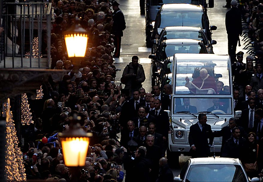 Pope Benedict XVI waves from his popemobile as he arrives for the traditional prayer to celebrate the Immaculate Conception, in Rome, Wednesday Dec. 8, 2010. Benedict inaugurated the Christmas season in Rome with his traditional visit to the posh Spanish Steps neighborhood to pray before a statue of Mary. Throngs of shoppers, tourists and Romans alike jammed the rain-slicked cobblestones around the piazza to catch a glimpse of Benedict . (AP Photo/Alessandra Tarantino)