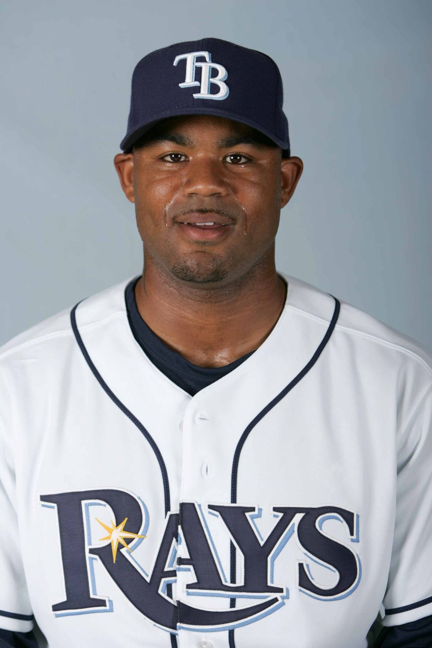 ** FILE ** This is a 2008 file photo of Carl Crawford of the Tampa Bay Rays baseball team. A night after Carl Crawford enjoyed a steak dinner with the New York Yankees, he served up a meaty surprise: He's going to play for the rival Boston Red Sox. A person familiar with the talks told the Associated Press late Wednesday, Dec. 8, 2010, the agreement was subject to Crawford passing a physical. (AP Photo/Chris O'Meara, File)