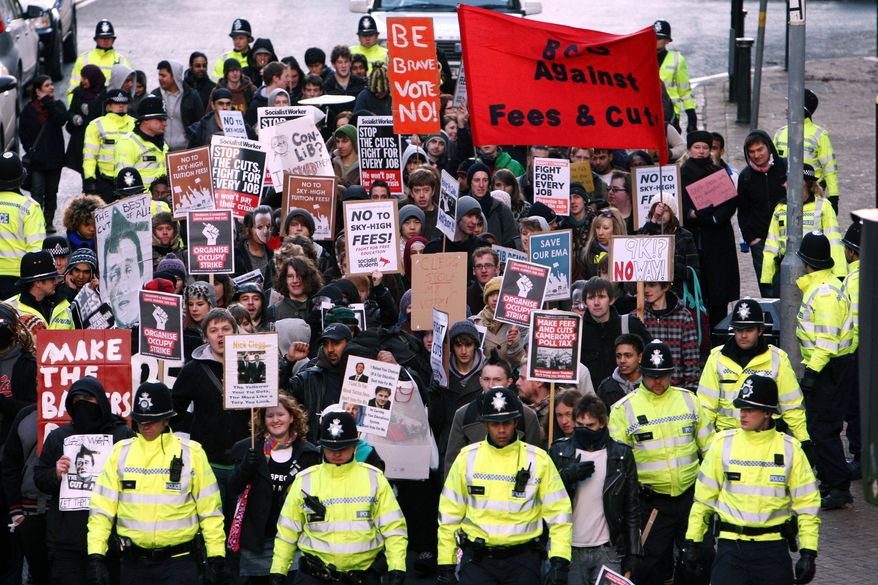 Students march through Birmingham, England, in protest at the increase in student fees Wednesday Dec. 8, 2010. (AP Photo/David Jones/PA Wire)