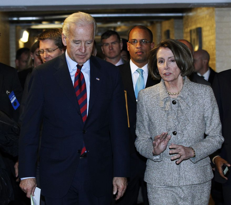 Vice President Joseph R. Biden Jr., left, and House Speaker Nancy Pelosi talk as they leave a Democratic Caucus meeting on Capitol Hill in Washington, Wednesday, Dec. 8, 2010. The House Democratic Caucus voted Thursday to reject President Obama's tax deal with Republicans in its current form. (AP Photo/Manuel Balce Ceneta)