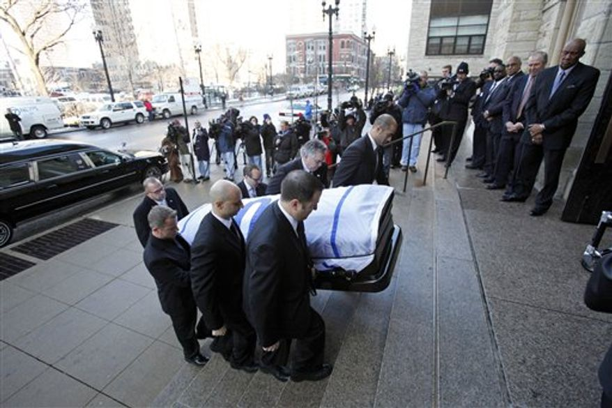 Vicki Santo, left, wife of Chicago Cub's great Ron Santo, watches as Monsignor Daniel G. Mayall blesses Santo's casket during funeral services at Holy Name Cathedral Friday, Dec. 10, 2010 in Chicago. The nine-time all-star died Dec. 2 in an Arizona hospital from complications of bladder cancer. He was 70. (AP Photo/Charles Rex Arbogast, Pool)
