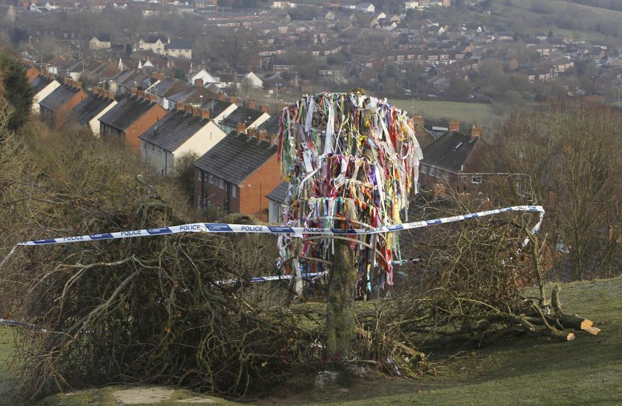 Paper decorations hang from the vandalized Glastonbury Holy Thorn Tree which has been hacked down and reduced to just a stump in Glastonbury western England Friday Dec. 10, 2010. The tree, a major Christian landmark in England, was vandalized just weeks before Christmas Day. The tree is said to be linked to the arrival of Saint Joseph of Arimathea in England after the crucifixion of Jesus. It draws hundreds of visitors each year.